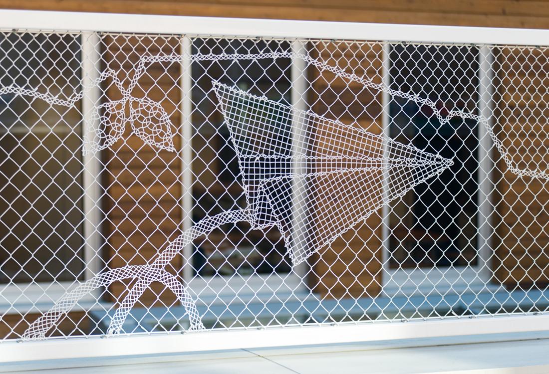 valla con tejido decorativo lacefence